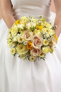 "#ChipotleWeddingSweepstakes  Nosegays are round clusters of flowers and a very trendy style of bridal bouquet. Also called a tussie mussie, this style of bouquet dates back to the 14th century, when it was used to mask unpleasant odors - thus the term ""nosegay."" Nosegays can vary in sophistication and are therefore a good choice for any wedding.Flowers Featured: roses, gerberas, ranunculus, mini carnations, freesia, asters, monte casino—"