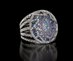 Magali Ring - This architecturally inspired design has gem set wires that are virtually suspended over a tiny sea of micro-set sapphires and diamonds. Intricately hand made with 742 stones.