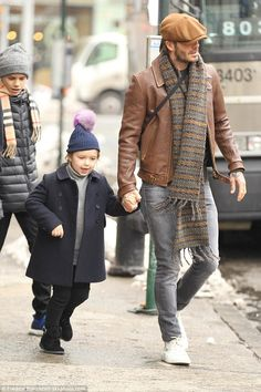 Daddy's day out: David Beckham put on a brave face as he was spotted in New York, leaving The Edition Hotel with his children Romeo, 14, Cruz, 11, and daughter Harper, five on Saturday.