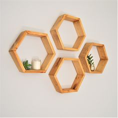 4 of our small hexagons in our pure pine finish Small Picture Frames, Hexagon Shelves, Small Potted Plants, Honeycomb Mirror, Staining Wood, Shelves, Geometric Shelves, Stud Walls, Dining Room Small