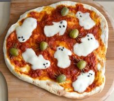 Ghost Pizza - You can turn your favorite homemade pizza into a Halloween meal by cleverly decorating it with ghosts and spiders. Just use cookie cutters to shape the cheese into ghosts, or cut it by hand. For the spiders, use olives and rosemary leaves for legs.