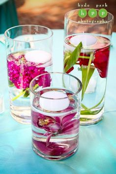 dollar store center pieces: silk flowers + distilled water + clear vases