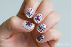 Fourth of July fireworks nail design; 4th of July nail art