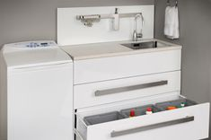 A mix of drawers, cupboards and baskets cater for the many tasks that are done in the laundry. Laundry Tubs, Laundry Storage, Long A, Cupboards, Washing Machine, Baskets, Drawers, Home Appliances, Armoires