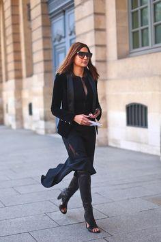Christine Centenera in a black velvet tuxedo blazer + black zip-up jacket + black skirt + black leather peep-toe over-the-knee boots
