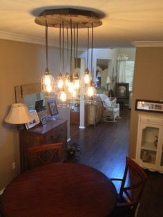 What a unique look this mason jar chandelier gives the room. Loving Born Again Woodworks!