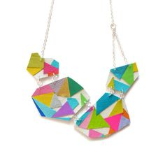 This neon geometric bib necklace is an explosion of color! I hand cut an assortment of rainbow colored leather, along with pops of shiny gold