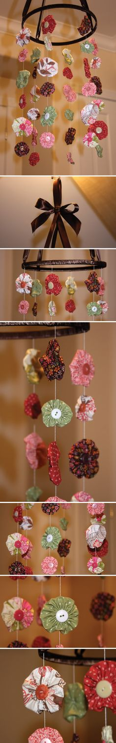 Here is super adorable sewing project! A nursery mobile made out of fabric yo-yos. I am not a huge fan of the mobiles with hanging plastic toys, so I love this shabby chic elegant option. {Etsy.com}