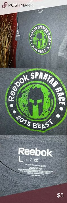 Grey Reebok athletic t-shirt Great for anyone who loves Reebok or athletic wear. Really cool large Reebok Spartan Race 2015 Beast t-shirt. Has the word finisher on the back. This shirt is in great condition. Reebok Tops Tees - Short Sleeve