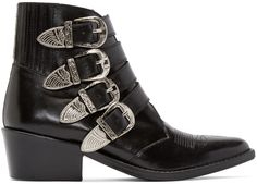 Buffed leather ankle boots in black. Accent stitching at pointed toe. Adjustable straps at vamp with silver-tone pin-buckle closures. Western-inspired carving at pin-buckles. Elasticized panel at heel collar. Stacked heel. Leather sole. Tonal stitching. Approx. 2
