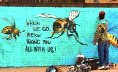 """""""When we go, we're taking you all with us!""""  This mural was done on a wall in London's East End. Photo credit: Louis Masai Michel"""