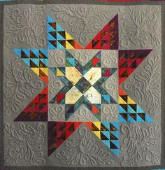 """center medallion, """"Borealis"""" by Maria Yeager, American Quilter Magazine 2010"""