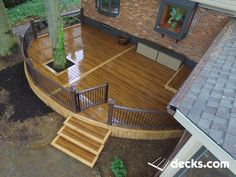 The crew built a beautiful curved deck for this customer. We incorporated an existing tree. Decking has an inlay accent board around the entire outside, down the center, and on each tread. They used the Timbertech Radiance Rail system complete with black aluminum balusters. They also added a lighting package (Post cap lights & riser lighting).