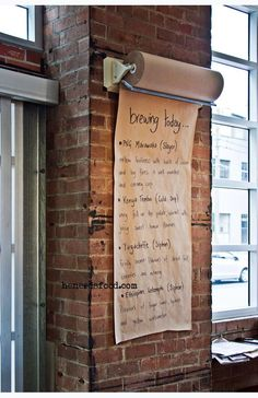 Butcher's paper roll coffee menu. Looks great against the exposed wall  I like this brown pper wall m enu idea too...very flexible and looks great...and cheap too. Really effective! PopUpRepublic.com