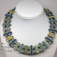 My first outing using carrier beads. The patterned beads are from the January Whimbeads Mystery Bead Along. I designing the mystery for the February bead along. Join the Facebook group to get updated information. These are so much fun!
