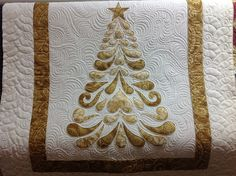 Christmas Tree |  pieced by Petra Watjen and quilted by Jessica Jones, Jessica's Quilting Studio  [I haven't seen this done in gold yet!  Lovely!]