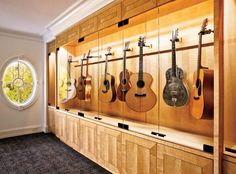 Custom guitar display cabinet: Quartered English Sycamore finished in a light stain with high gloss to accentuate the wood grain; Bragging rights: 3rd place (Specialty Room), 2010 Detroit Home Design Awards.