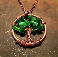 This is a handmade copper jewery pendant of the Norse Tree of Life, Yggdrasil. The finely aged copper wire is strung with green cats eye seaglass Wire Wrapped Jewelry, Wire Jewelry, Pendant Jewelry, Jewellery, Aged Copper, Copper Wire, Tree Of Life Jewelry, Handmade Copper, Handicraft