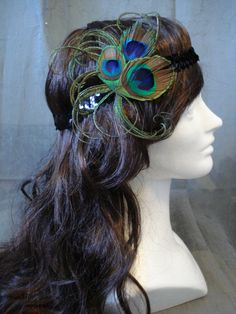 Love the feathers, not sure about the headbandiness. Peacock feather Burlesque 1920s flapper style headband by Axentz, $25.00