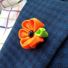mens lapel flower // mens boutonniere // wedding lapel pin // unique lapel flower // neon orange via Etsy