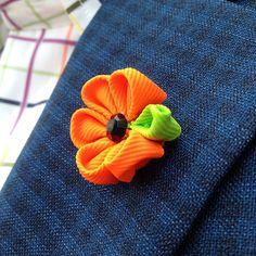 mens lapel flower // mens boutonniere // wedding lapel pin // unique lapel flower // neon orange via Etsy
