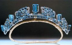 Aquamarine Pine Flower Tiara was commissioned by HM King George VI from Cartier, London, as a 15th wedding anniversary gift for his wife HM Queen Elizabeth in 1938. This tiara is composed of aquamarines and diamonds arranged in a pine cone motif (hence the 'pine flower' designation), interspersed with large upright rectangular aquamarines and smaller diamonds. Princess Anne has inherited the tiara currently.