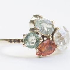 Custom Mocium jewelry ... this would be beautiful as a family birthstone ring.