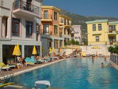 Villa Lycian Kalkan Lycian offers apartments and villas with a private balcony and Mediterranean Sea views. There is an outdoor swimming pool where guests can unwind under the shade of a parasol.