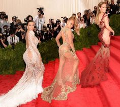 If there's one thing on everyone's minds right now, it's the booty. Songs about bootys, people's bootys, summer bootys. At the Met Gala tonight, three queens — Jennifer Lopez, Kim Kardashian, and Beyoncé — showed off their famous bootys (andthen some)in weirdly matching gowns. J.Lo , original queen of the revealing gown, trusted Versace to once more make a statement, and a statement she made in a sheer dress with a dragon appliquéd that wrapped all around her body (giving us majorBai Ling…