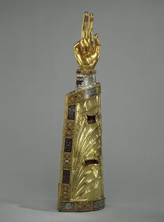 Reliquary Arm, ca. 1230, South Netherlandish - Silver over oak; hand: bronze-gilt; applique plaques: silver-gilt, niello and cabochon stones    http://www.metmuseum.org/toah/works-of-art/47.101.33