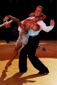STUNNING BALLROOM DANCING:: What I love most about these two, is that besides striking the most amazing postures and poses, they almost always have a look of transcendence in their faces.