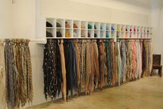 scarf display ...I like the idea (for any type of merch) to display one and fold or roll the back stock above or below to save on space but still easily view the item.