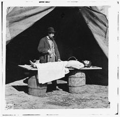 """""""Civil War photograph, c. 1864    Embalming surgeon at work on soldier's body"""""""