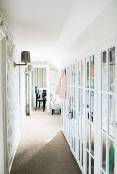 Storage and Closet Idea using glass doors / french doors. Would also look great with leaded glass doors. Yes!