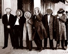 1920's bootleggers hide their identities  having been caught red handed