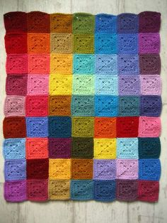 31 Colourful Home Decor Ideas - 23 Knitted rainbow square quilt - Diy