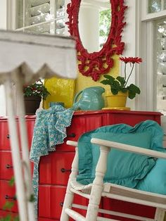 I love the turquoise, coral red, & yellow together. cute. I am huge fan of using primary colors together. I think it would be especially cute in my sun room where I would set up my easel.