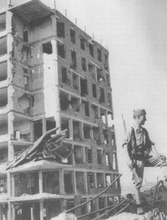 Spain - 1939. - GC - A Nationalist soldier stands guard in the ruins of Madrid following its capture in late March of 1939.