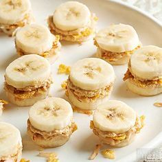 Looking for healthy snack ideas for after-school treats? With crunchy cornflakes, sweet flaked coconut, and peanut butter sandwiched between banana slices, these cute-as-a-button bites will satisfy everyone's cravings until dinner.  /