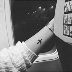 Small Tattoos for Women – Best Tattoo Designs for Women-Airplane-Let everyone know you're an insatiable traveller. Discover more creative tattoo designs at redbookmag.com.