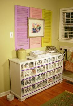 Repurposed dresser:  drawers removed, storage bins added.