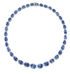 A sapphire and diamond necklace, by Bulgari Set throughout with graduated oval mixed-cut sapphires, spaced by brilliant-cut diamonds, mounted in platinum, diamonds approximately 3.45 carats total, signed Bulgari, length 40.0cm, fitted case by Bulgari [Yum]