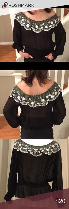 Classy Kay Celine embroidered blouse Beautiful and sexy black sheer blouse with white embroidered sequences. Size M. It was washed to shrink the size. It fits like small. kay Celine Tops Blouses