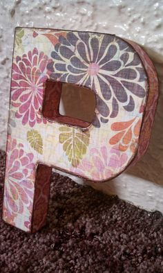 Custom Paper Mache Letter. $10.00 but could probably DIY with some cool fabric and paper mache letters...