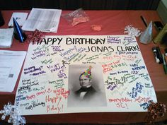 Clarkies sign a birthday card for Jonas Clark.