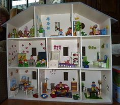 Very cute dollhouses... Possible DIY project.