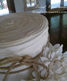 Burlap and twine, a casual yet classically elegant combination. ##burlapandtwinecakes##casuallyelegantcakes##burlapweddingcakes##