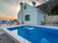 House in Makarska, Croatia. Cottage for 6 persons with heated pool, above the town of Makarska, in the hamlet Kotisina, an idyllic and peaceful location with beautiful panoramic views of the town of Makarska, the sea and the islands.  The house has three bedrooms, kitchen, l...