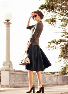 Stacked heels with cardigan and full skirt.