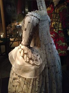 Robe a la francaise of cotton embroidered in silver and gold.